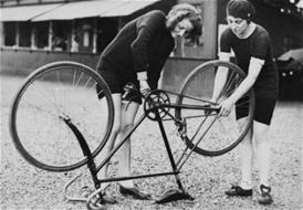 women fixing bike_thumb.jpg