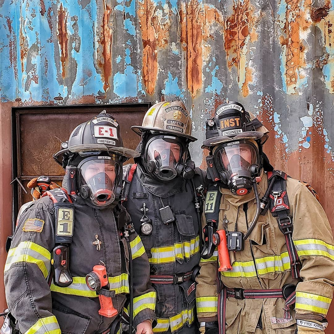 Three Billings Firefighters pose before conducting a live fire drill.